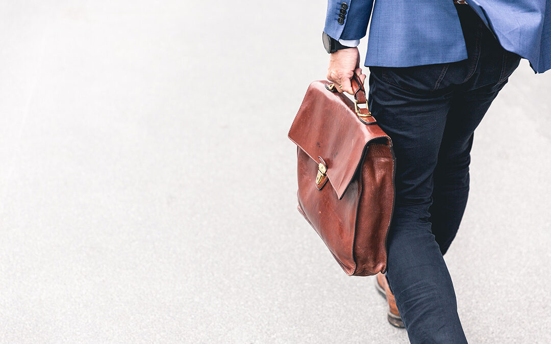 five reasons why your small business needs a lawyer. Man carrying briefcase to signify he'll help you out.